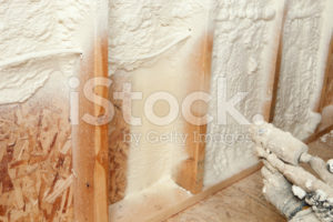 stock-photo-19413859-construction-worker-spraying-expandable-foam-insulation-between